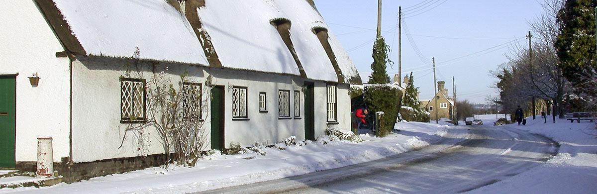 Houses by Whaddon village hall in snow